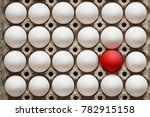 packing eggs with one red egg....   Shutterstock . vector #782915158