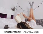 woman in cozy home clothes... | Shutterstock . vector #782967658