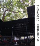 Small photo of Negros Oriental, Philippines; December 27, 2017: Trees tower above the open-air Tree Hive Food Hub in Dumaguete City forming a canopy of greenery and giving a natural ambiance for its customers.