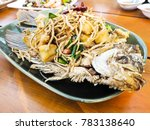 fried fish with herbs   thai... | Shutterstock . vector #783138640
