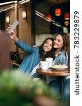 Women Meeting In Cafe. Friends...