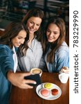 beautiful girls in cafe taking... | Shutterstock . vector #783229990