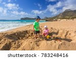 twins playing in the sand on... | Shutterstock . vector #783248416