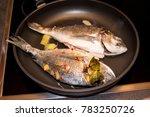 cooking sea bream | Shutterstock . vector #783250726