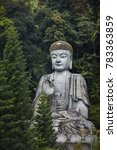 a large buddha statue sits on a ... | Shutterstock . vector #783363859