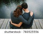 Couple Cuddling On The Pier