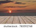 wooden deck floor over colorful ...   Shutterstock . vector #783592768
