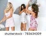 pillow fight. sexy women having ... | Shutterstock . vector #783634309