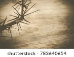 Small photo of A crown of thorns on wood background