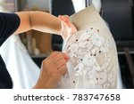 closeup of woman hand sewing a... | Shutterstock . vector #783747658