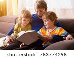 grandmother reading a tale to... | Shutterstock . vector #783774298