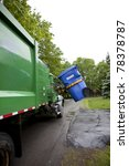 Recycling truck picking up bin - Vertical - stock photo