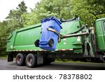 Recycling truck picking up bin - Horizontal - stock photo
