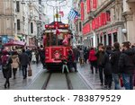 crowded people and red tramway... | Shutterstock . vector #783879529