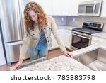 young woman opening inspecting... | Shutterstock . vector #783883798