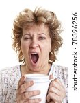 Woman waking up with a coffee (Yawning) - stock photo