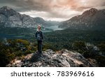 woman hiker stands and enjoys... | Shutterstock . vector #783969616