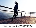 sporty female jogger morning... | Shutterstock . vector #783974974