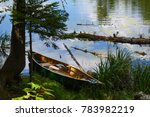 Canoe Sits Peacefully On The...