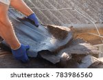worker demolishing old shingles ... | Shutterstock . vector #783986560
