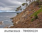 jagged sheer cliffs  white... | Shutterstock . vector #784004224