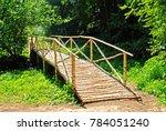 A Wooden Bridge Over A Stream...