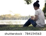 young women writing on... | Shutterstock . vector #784154563