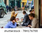 parisians and tourists enjoy... | Shutterstock . vector #784176700