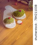 white slippers on a wooden... | Shutterstock . vector #784211038