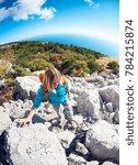 a girl walks along the mountain ... | Shutterstock . vector #784215874