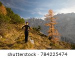 young female trekker is...   Shutterstock . vector #784225474