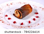 rolled fish with pomegranate... | Shutterstock . vector #784226614