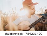 Young Bearded Man In Hat Tunin...
