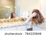 one young woman checking hair... | Shutterstock . vector #784235848