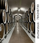 Small photo of YALTA, CRIMEA - MAY 04, 2013: Wines in wooden barrels in a cellar at the Massandra winery, Yalta, Crimea, on May 04, 2013. Collection wines in Massandra winery is one of the largest collection