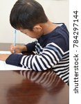 japanese boy doing homework ... | Shutterstock . vector #784297144