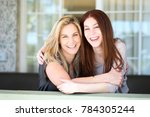 latin mother and teen daughter. | Shutterstock . vector #784305244