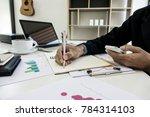 business man working on paper... | Shutterstock . vector #784314103