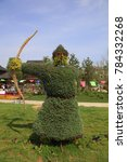 Small photo of shooter green sculpture in the park, China