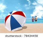 Umbrella on the beach - stock photo