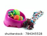Stock photo pet supplies set about bowl rope rubber toys for dog or cat on white background 784345528
