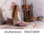 young woman in a white knitted...   Shutterstock . vector #784372849