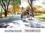 asian teenage boys riding... | Shutterstock . vector #784380520
