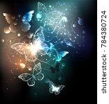 night glowing butterflies on a... | Shutterstock .eps vector #784380724
