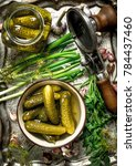 pickled cucumbers with herbs... | Shutterstock . vector #784437460
