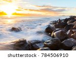 person sitting on rocks at... | Shutterstock . vector #784506910