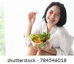 'happy young asian woman with... | Shutterstock . vector #784546018