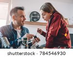 father and daughter working... | Shutterstock . vector #784546930