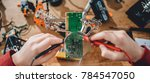 girl checking circuit board... | Shutterstock . vector #784547050