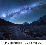 milky way and mountains.... | Shutterstock . vector #784574500
